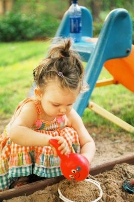 Keep your child's sandbox clean with a protective animal-proof cover.