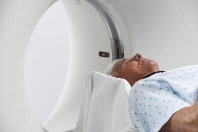 Man going into MRI machine