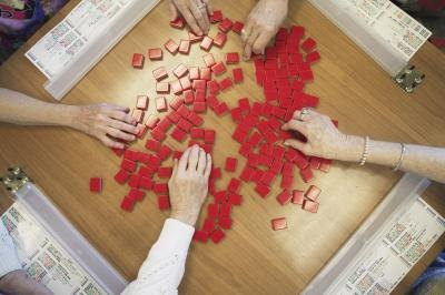people picking tiles for Mahjong