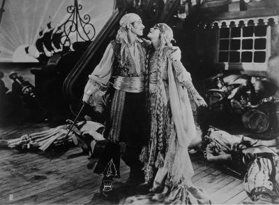 A romantic scene between a pirate and a damsel, circa 1918