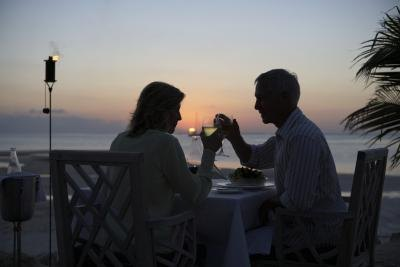 Couple toast at sunset at Little Torch Key resort terrace