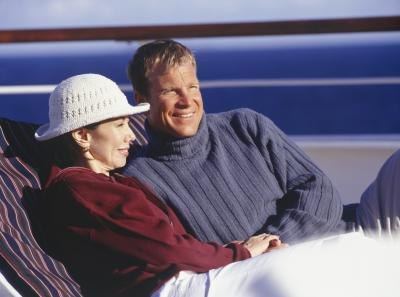 A couple enjoys the view in lounge chairs.