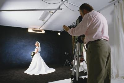 A bride-to-be poses in the wedding photographer's studio.