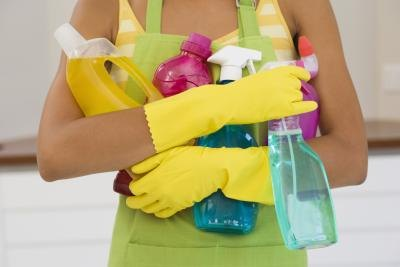 Woman with cleaning supplies.