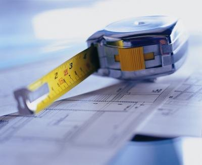 Tape measure on blueprints.