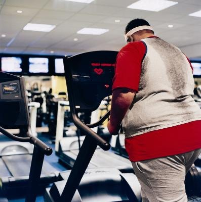 Man viewing heart monitor on exercise machine