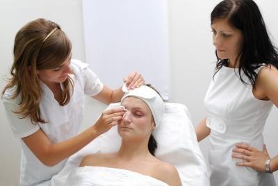 beautician with customer - Beautician Job Description