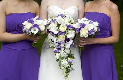 Bride and bridesmaids with flowers.