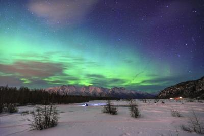 The aurora borealis is seen looking over Knik River in Alaska.