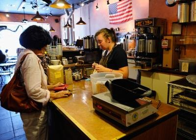 Barista helping customer at counter