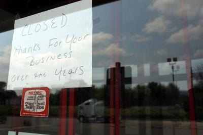 Sign on window of closed video store in New York