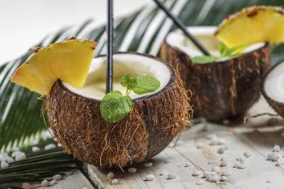 Close-up of two cocktails served in coconut shells