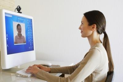 Woman uses webcam to Skype