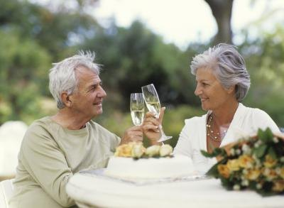Mature couple toasting a glass of champagne.