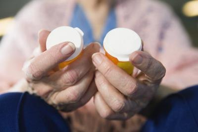 woman holding two bottles of medication
