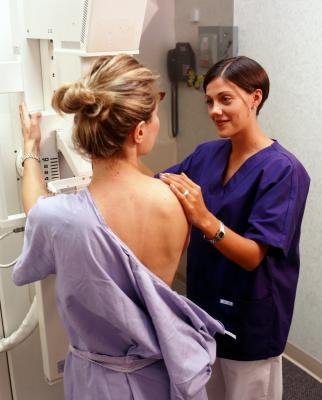 Nurse with patient in mamogram