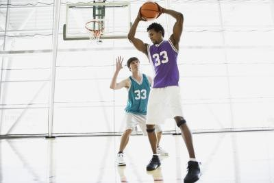 A short person has to be comparatively better at basketball or football if he wants to compete with taller players.