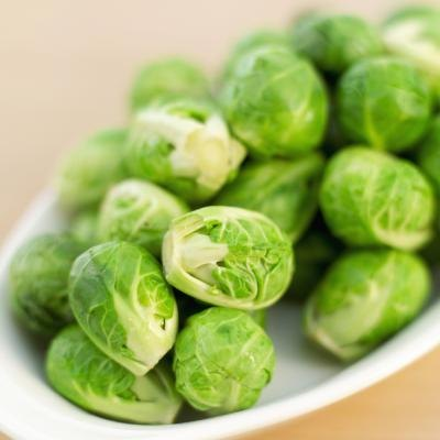 A bowl of fresh brussels sprouts.