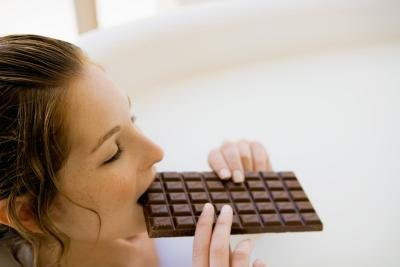 woman eating chocolate bar