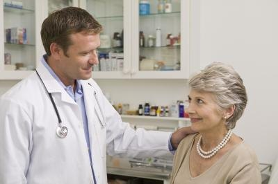 older woman speaking with doctor