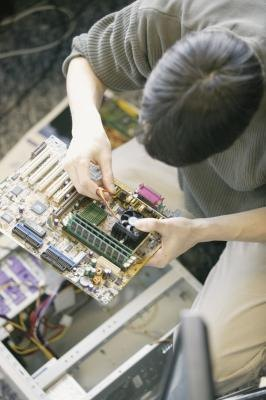 Man working on computer parts