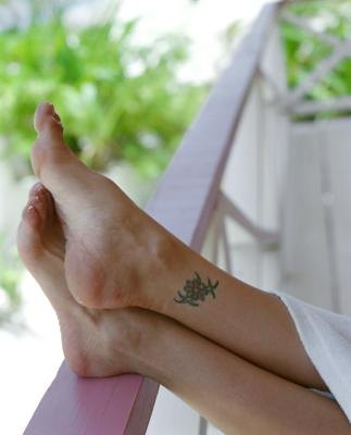 Ankle tattoos can be small and non-threatening.