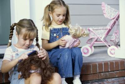 Girls playing with dolls