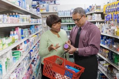 couple looking at vitamins in store