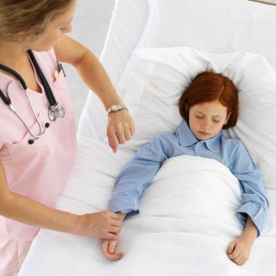 Nurse taking child's pulse