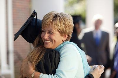 Mom hugging graduate
