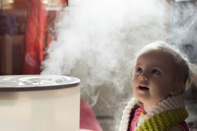 Young child next to humidifier