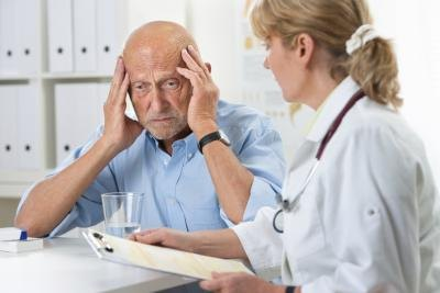man with headache at the hospital