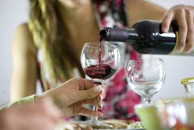 Woman pouring a glass of wine