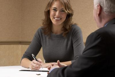Woman interviewing man
