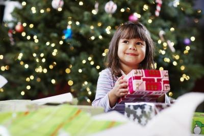 Young girl holding Christmas present