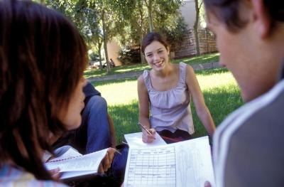 Group of people studying together outdoors.