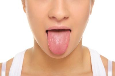 Bumps or membranes on tongue are a symptom.