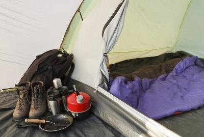 Assortment of camping gear next to tent