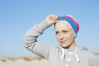 Woman without hair due to chemotherapy.
