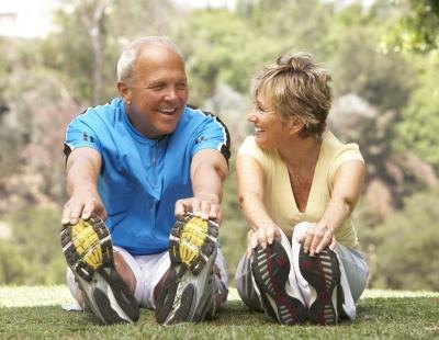 retired couple exercising and stretching