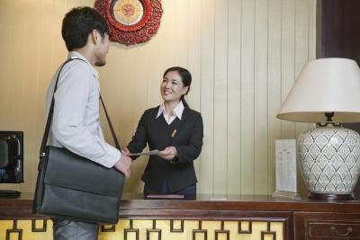 Concierge helping guest