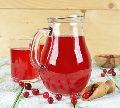 Pitcher and glass full of cranberry juice