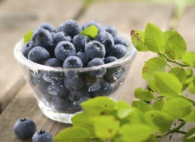A glass bowl of blueberries