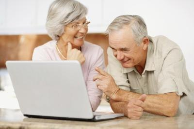 retired couple on a computer