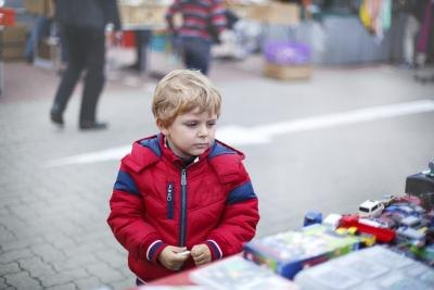 child at outdoor flea market