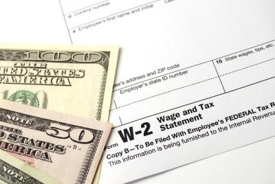 Money with W-2 forms.
