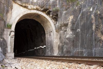 Railroad track going into tunnel