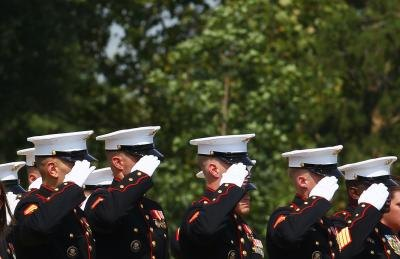 Group of US Marines salute