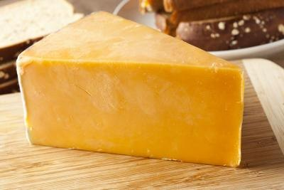 block of sharp cheddar cheese