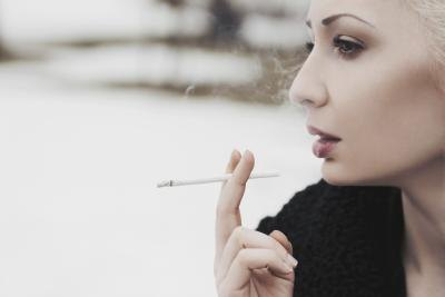 Woman smoking outdoors.